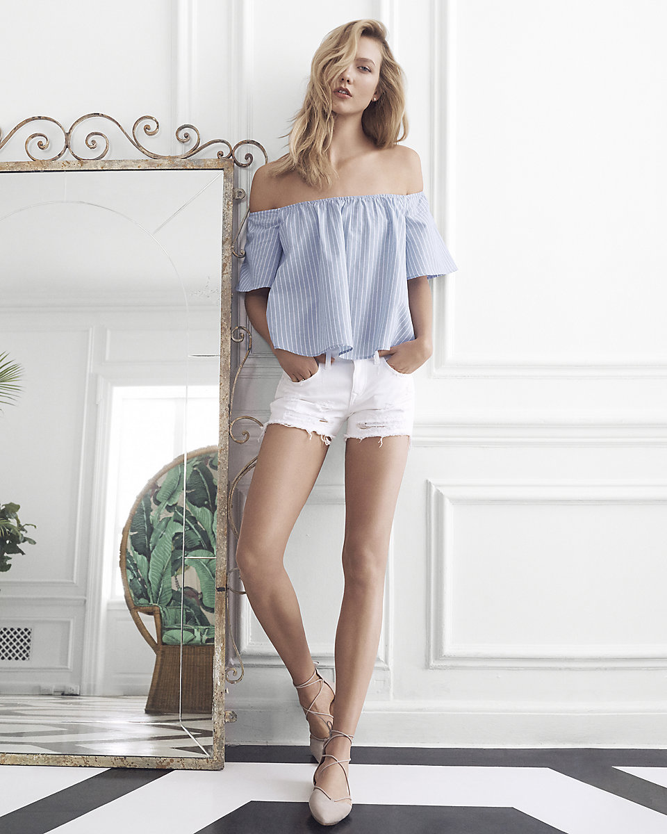 Beautiful Fashion Model Karlie Kloss Modeling For EXPRESS Blue Off The Shoulder Tops Modeling As One Of The Highest Paid Models In The World.