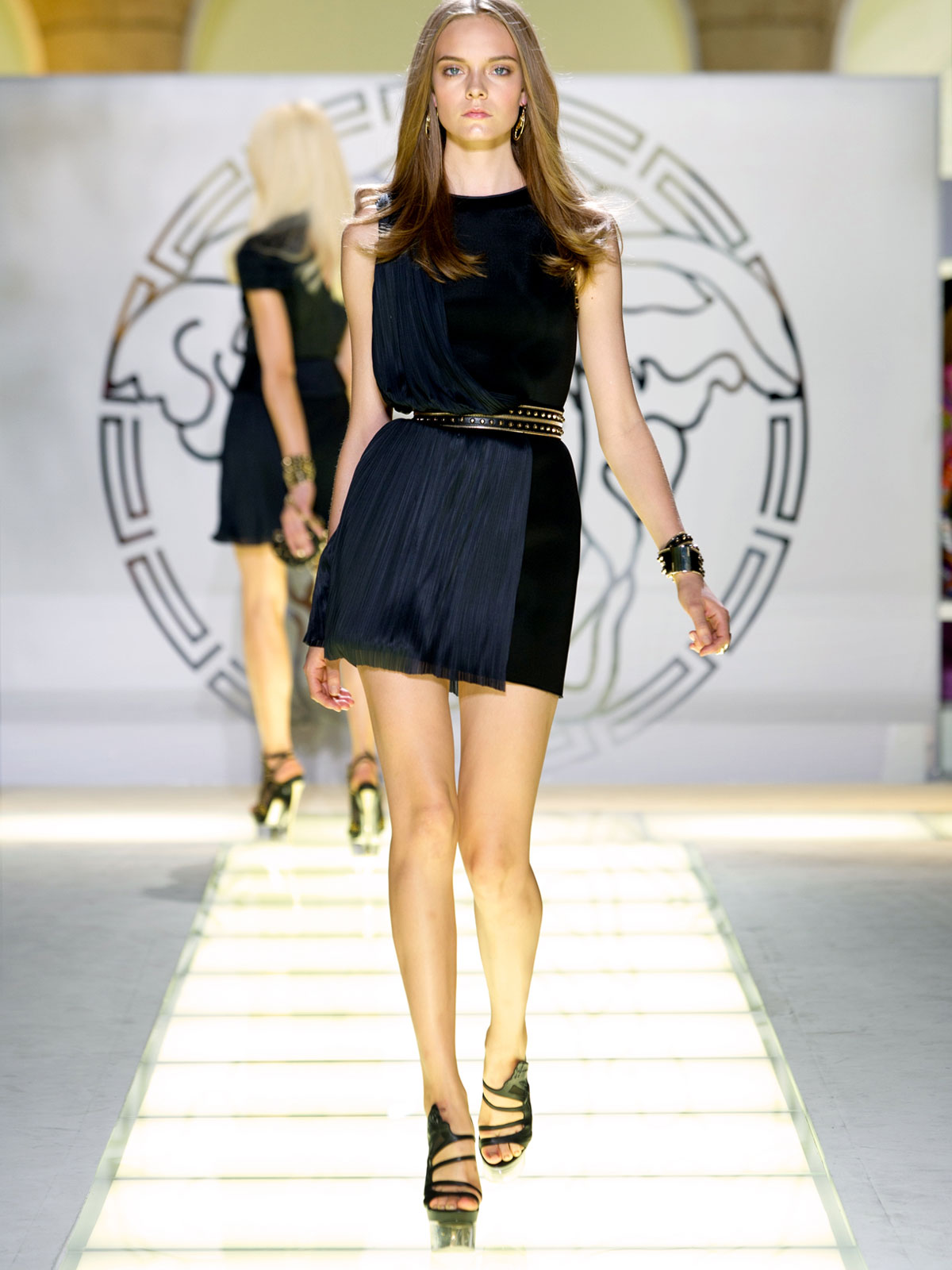 Versace Fashion Runway Show With Beautiful Versace Models Modeling Versace Dresses And Skirts On The Fashion Runway.