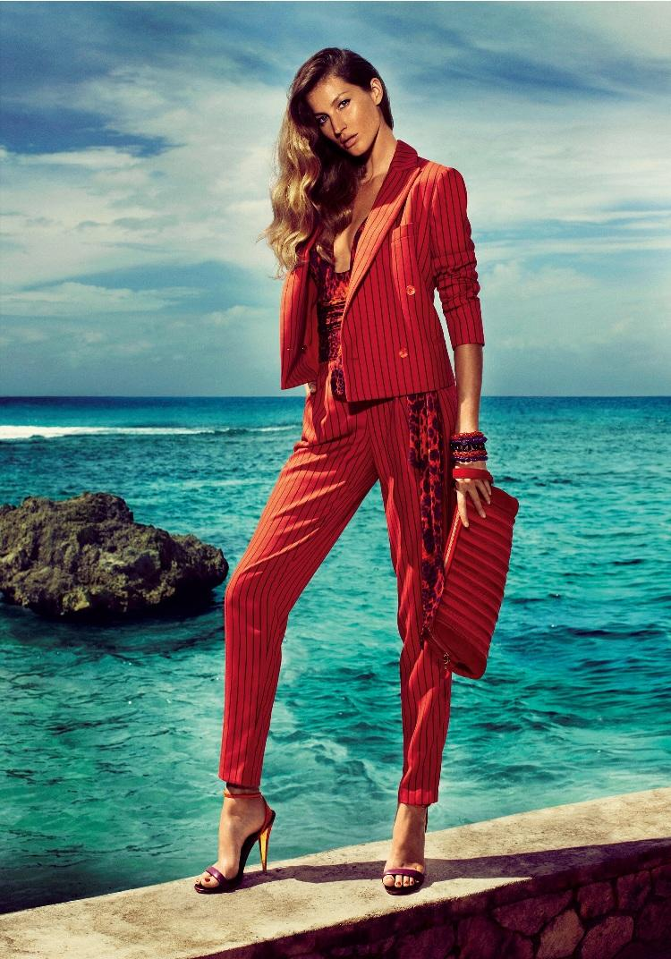 Beautiful Model Gisele Bundchen Modeling For Salvatore Ferragamo Spring Summer Fashion Advertising Campaign Modeling In Sexy Red Pants And Jackets Wearing A Salvatore Ferragamo Red Purse As The Highest Paid Model In The World