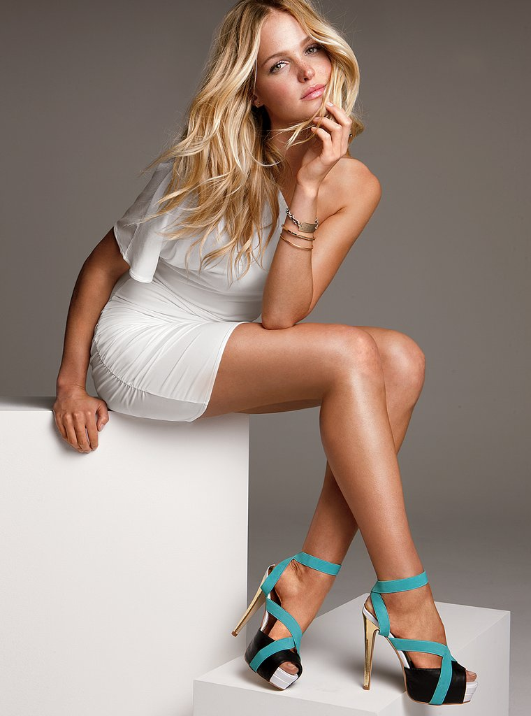 Beautiful Blonde Victoria's Secret Model Erin Heatherton Modeling In Sexy White Victoria's Secret Dresses And Black Light Blue White Gold Heels For Victoria's Secret Ads As One Of The Highest Paid Models In The World.