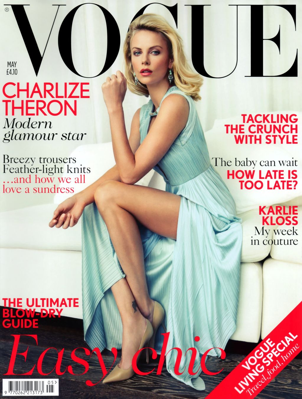 Beautiful Blonde Actress Charlize Theron Modeling For The Cover Of British Vogue Magazine Modeling As One Of The Highest Paid Actresses In The World. Actress Charlize Theron Photographed By Patrick Demarchelier.