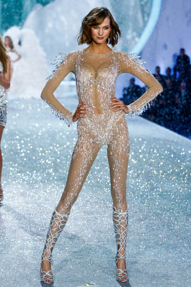 The Victoria's Secret Fashion Show Featuring Beautiful American Victoria's Secret Model Karlie Kloss Modeling For Victoria's Secret In Sexy White Victoria's Secret Lingerie After Her Successful Victoria's Secret Fittings.