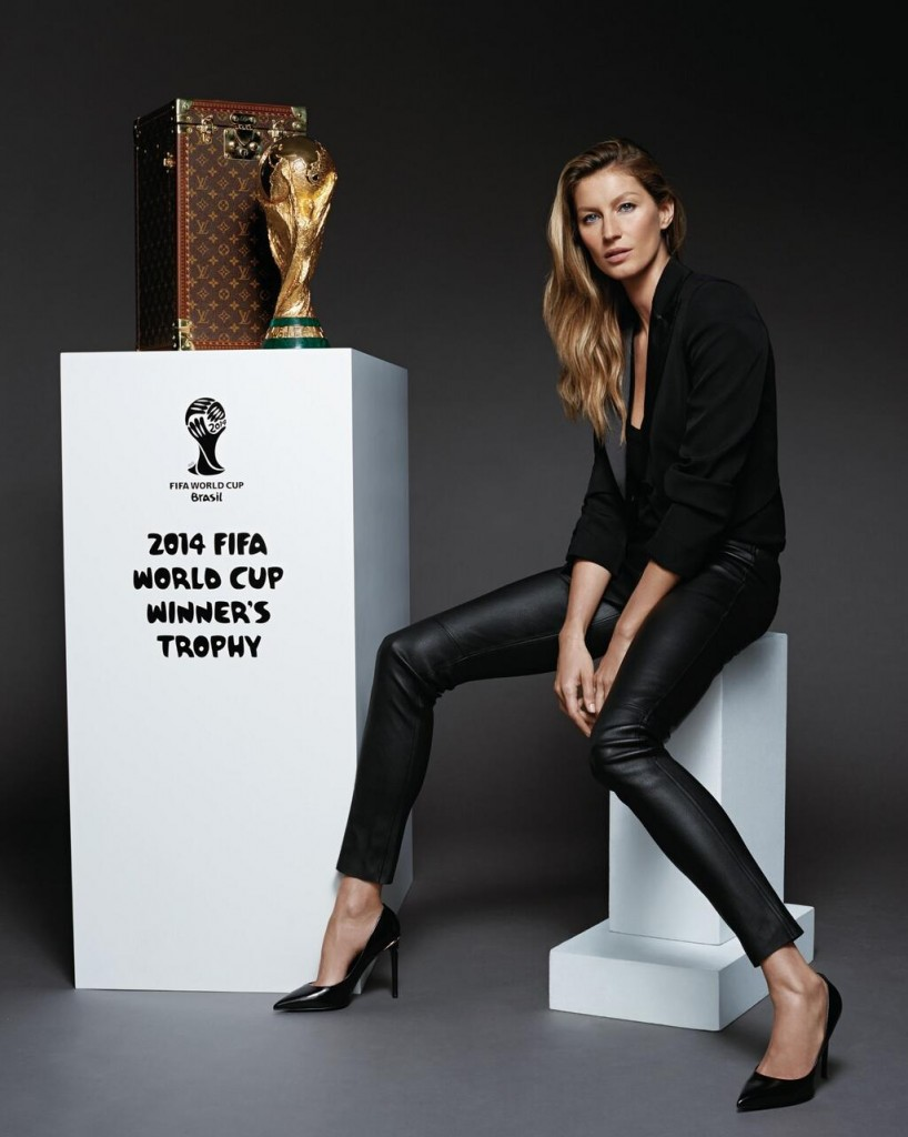 Beautiful Brazilian Fashion Model Gisele Bundchen Modeling Next To The FIFA World Cup Soccer Trophy Modeling As The Highest Paid Model In Brazil (Brasil) With Model Earnings Of $47 Million Dollars During The Past Year (Past 12 Months).