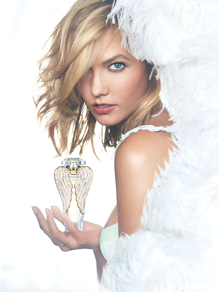 Beautiful Blonde Victoria's Secret Model Karlie Kloss Modeling For The Famous Victoria's Secret Heavenly Fragrance Advertising Fragrance Campaign Modeling As One Of The Highest Paid Models In The World.