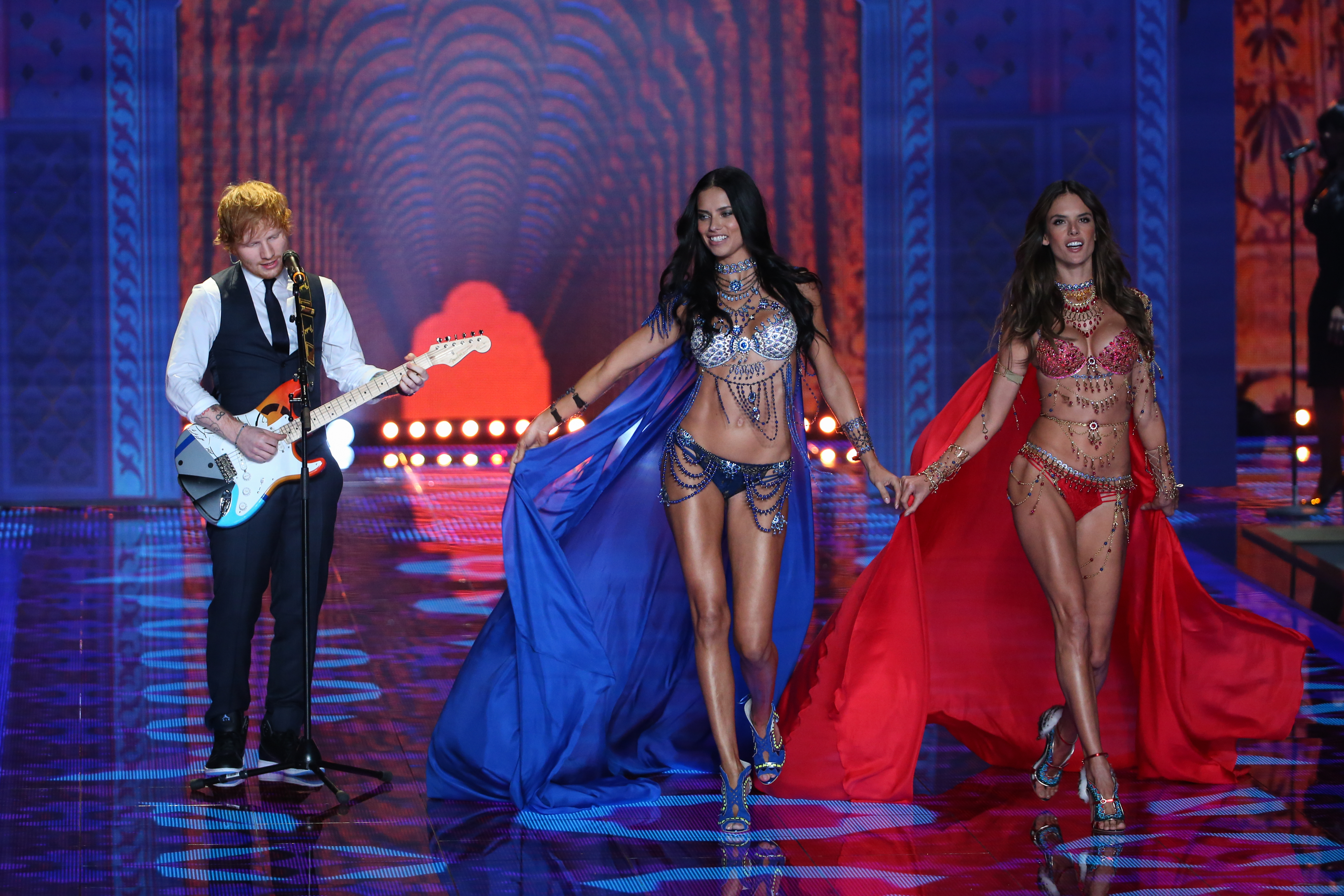 Ed Sheeran Performs As Victoria's Secret Lingerie Models Adriana Lima And Alessandra Ambrosio Walk The Fashion Runway At The Annual Victoria's Secret Fashion Show At Earls Court In London, England, United Kingdom.